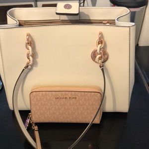 white and rose gold Michael Kors purse and wallet